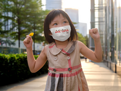face-mask-mockup-of-a-happy-little-girl-