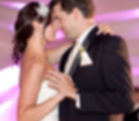 Bride and groom with uplighting and day of coordinator wedding planner