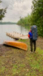 Maria Neuzil with FR pack and canoe.jpg