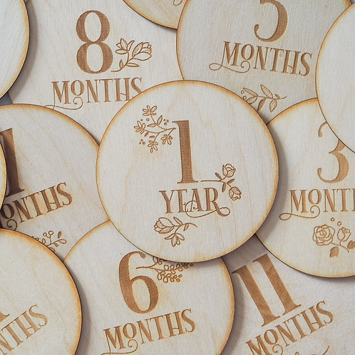 A Set of 12 Floral Wooden Milestone Discs