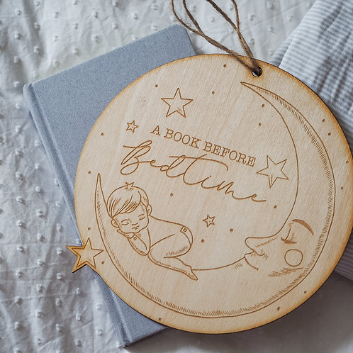 """A Book Before Bedtime"" Nursery Book Shelf Plaque with Sleepy Baby, Moon & Stars"