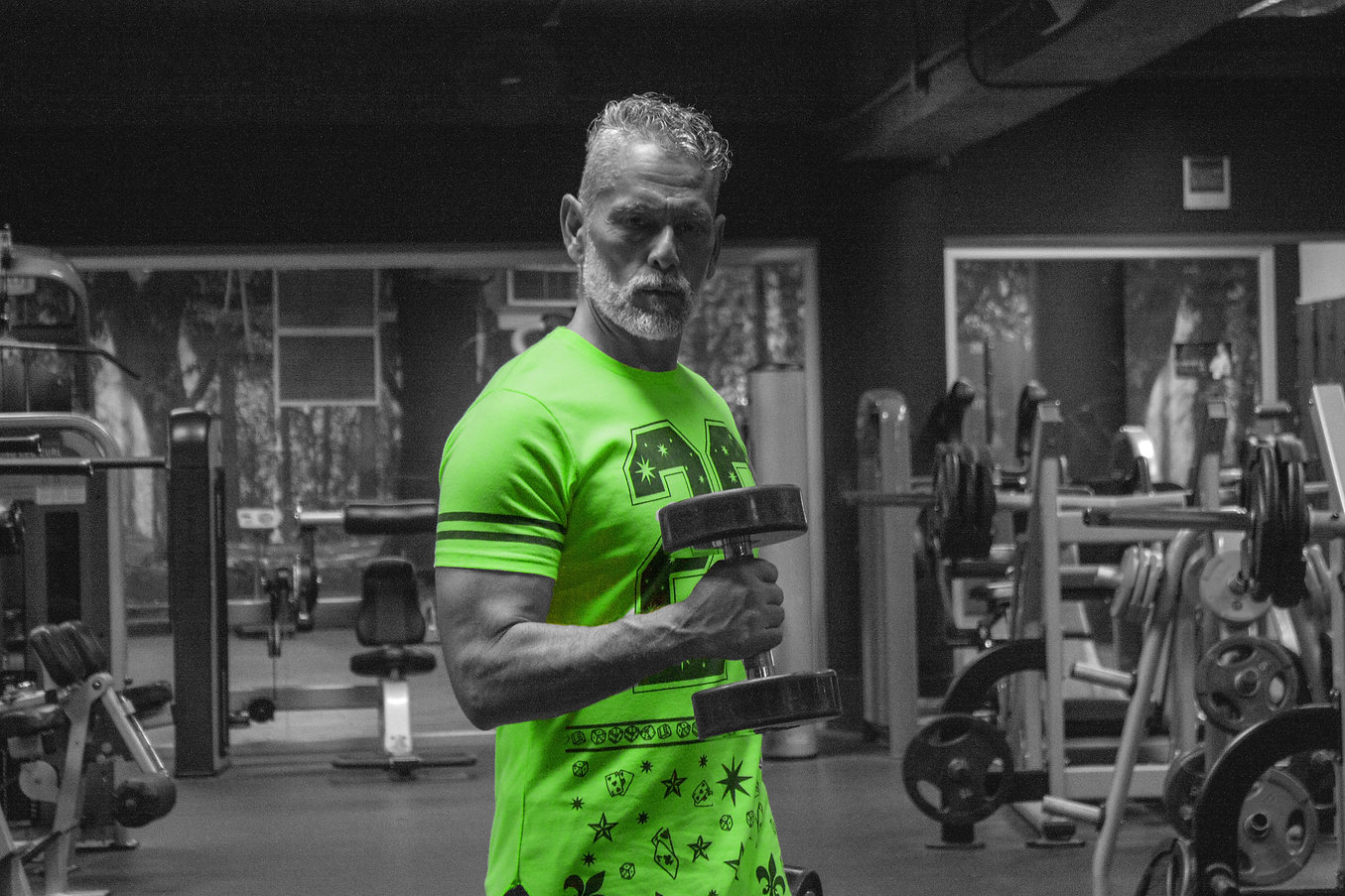 Man in green shirt working out.jpg