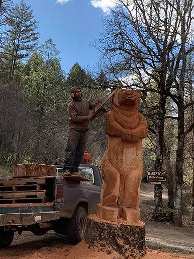 3. Jens Carving Bear at Entrance to Camp