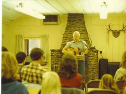 Chris leading singing 1984