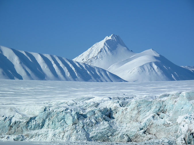 Glacier and mountains in the white land.