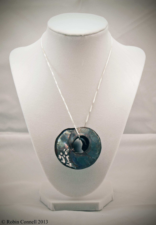 Raku enamel pendant.