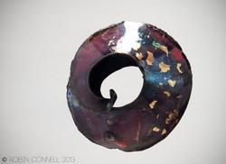 Raku fold formed bead.