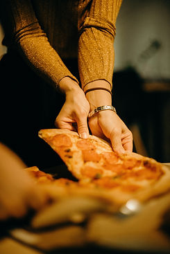 woman-picking-pizza-3171766.jpg
