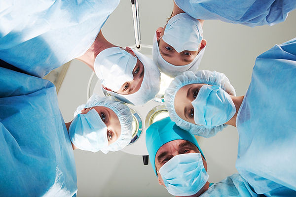 Surgeons with surgical masks