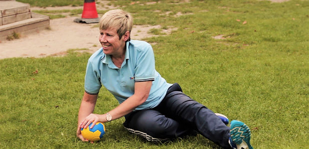 Activities for preschoolers - Jan Morgan teaching goalkeeping to toddlers during a football lesson - Tots in Sport