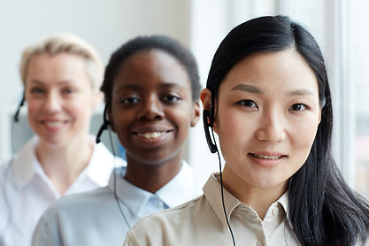 smiling-asian-operator-standing-in-row-H