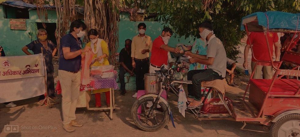 AAA social workers are giving hygiene kits, food and water to a rickshaw puller during COVID