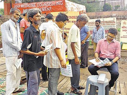 Four homeless men waiting near jama masjid clinic for doctor's consultation