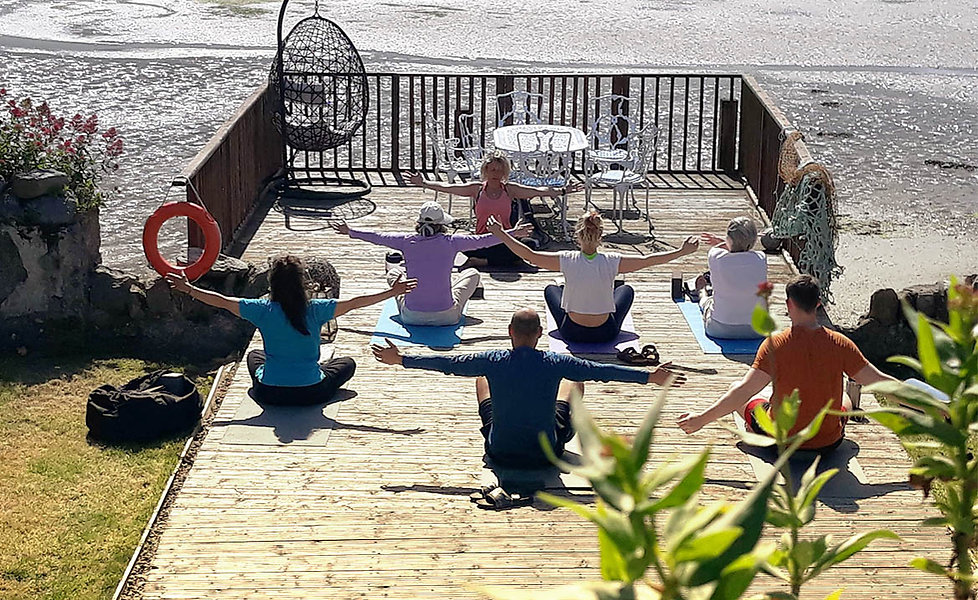 A group practices yoga on the boatdeck a