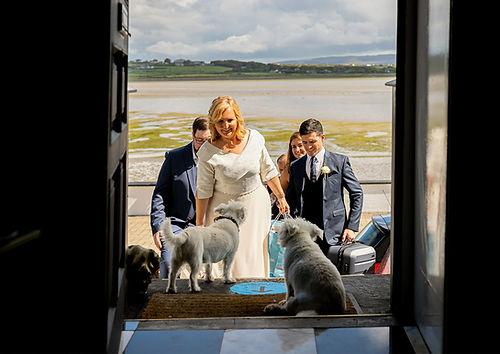A bride enters Barrow House.jpg