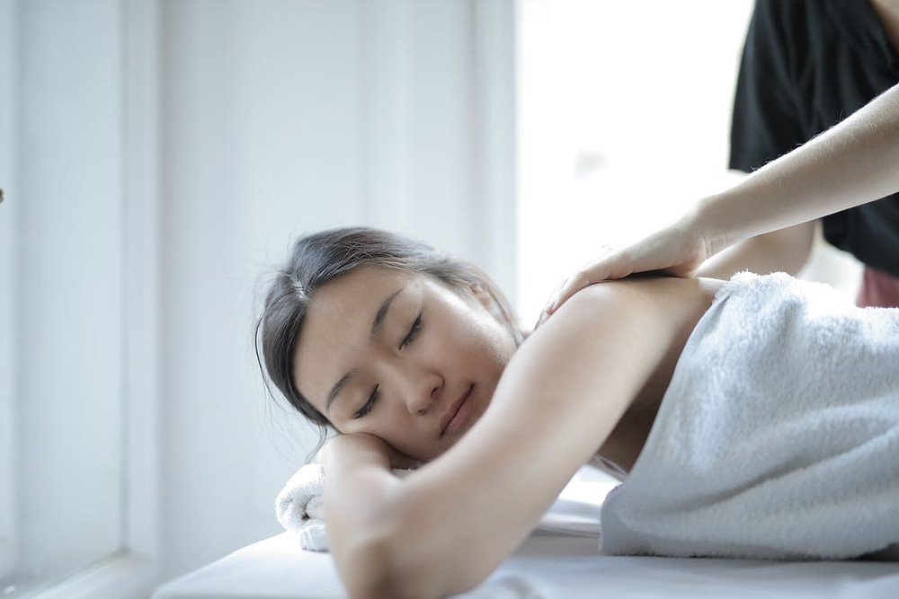 A woman getting a lymphatic drainage massage in a spa