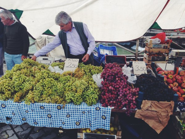 Piles of fresh grapes and other fruits