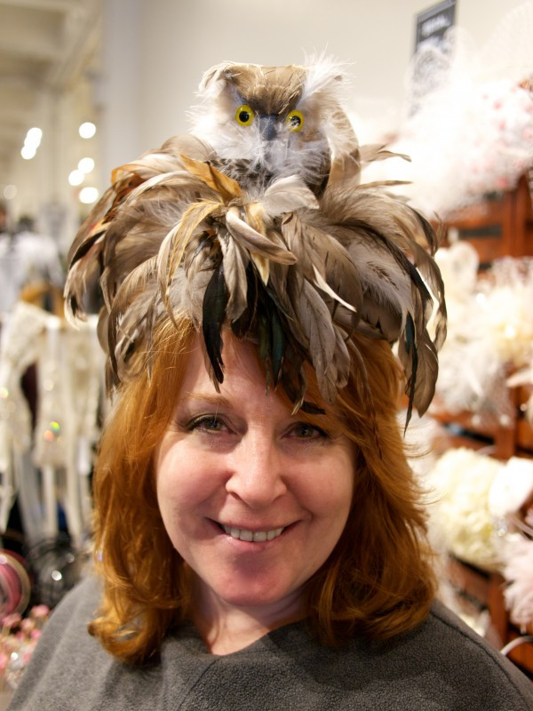 Whoo Is this? It's a sweet little owl perched atop on Designer Dora Marra herself!