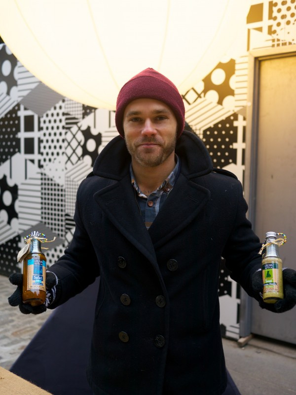 Joey Cameron, Managing Director of Ukuva iAfrica selling hot sauces in a cold at the Out to See Market
