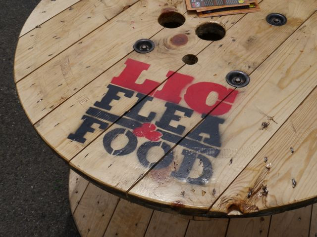 Tables with the LIC Flea & Food Logo