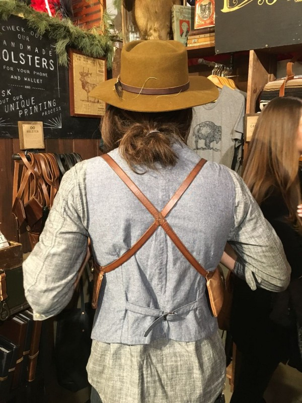 Holster from the back, wearable as an accessory or hidden under a jacket for traveling