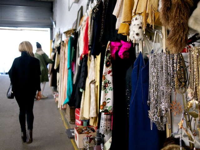 Vintage clothing from many ages on the walls of the Antiques Garage