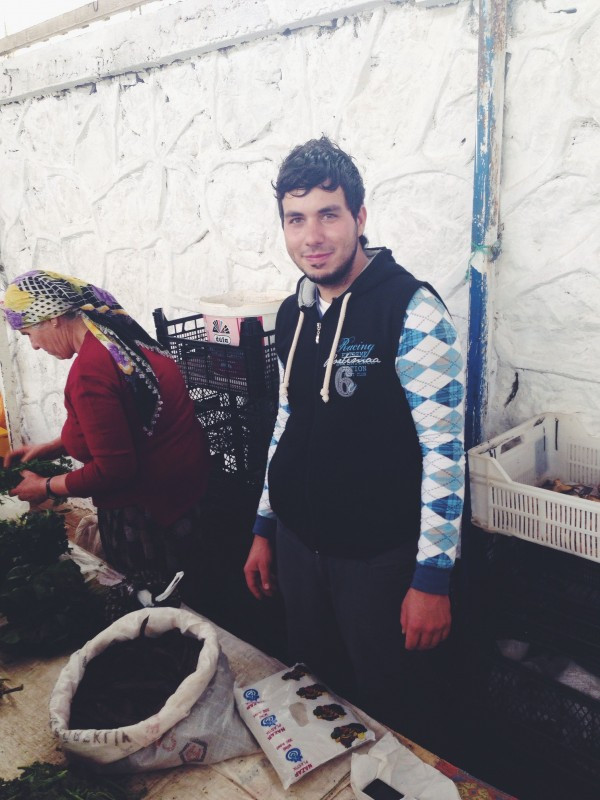 Ibrahim selling carob pods from his family's trees