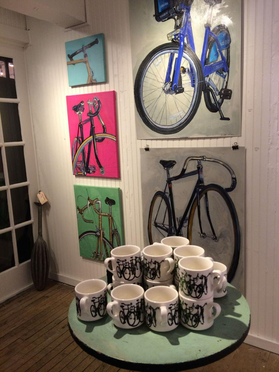 Bicycle paintings by Taliah Lempert and her mugs at Fishs Eddy