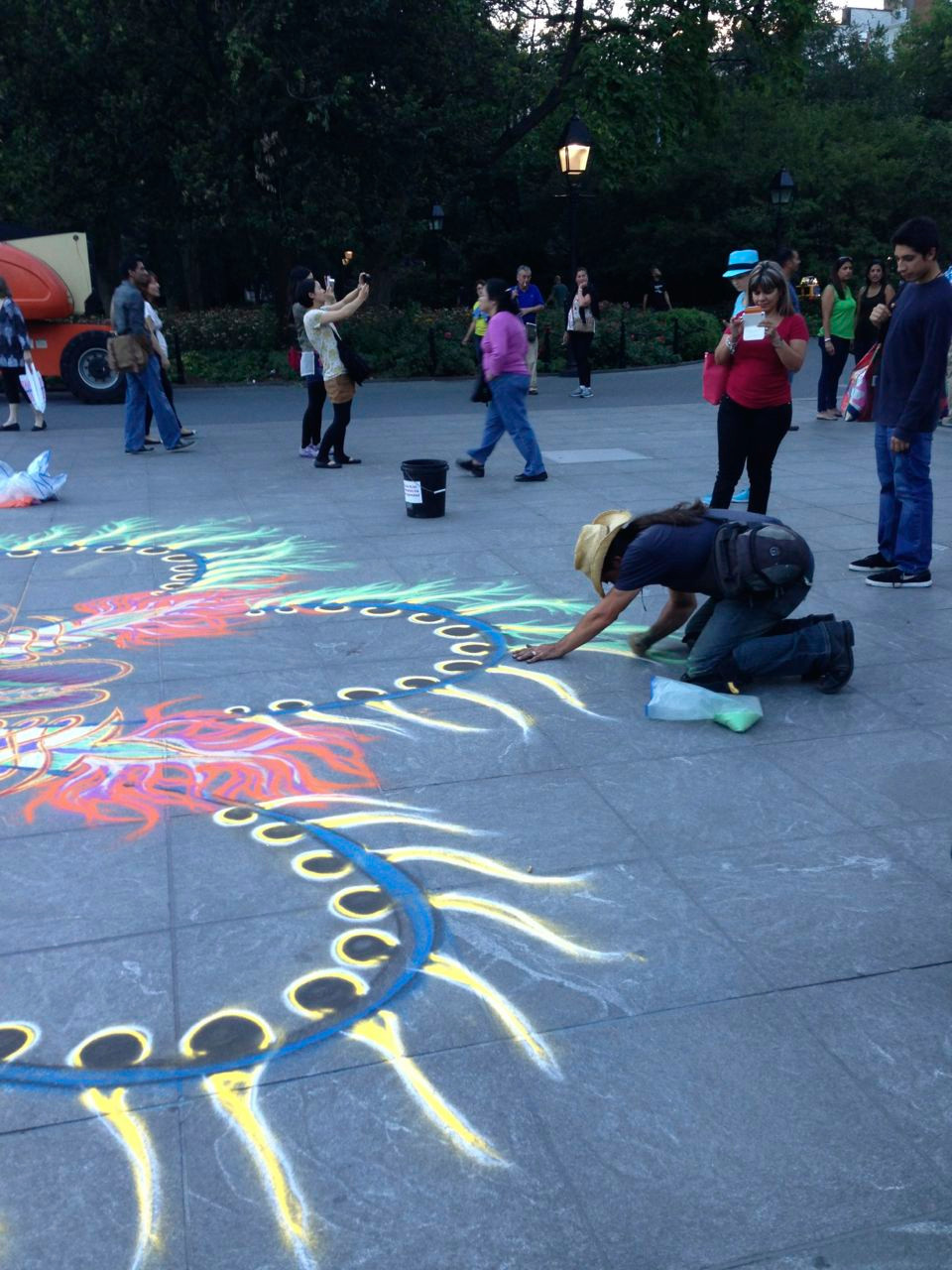 Joe Mangrum at work on a sand paining in Washington Square Park