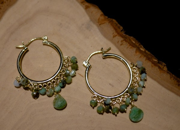 Earrings by Atlantis Jewelry on a wooden display