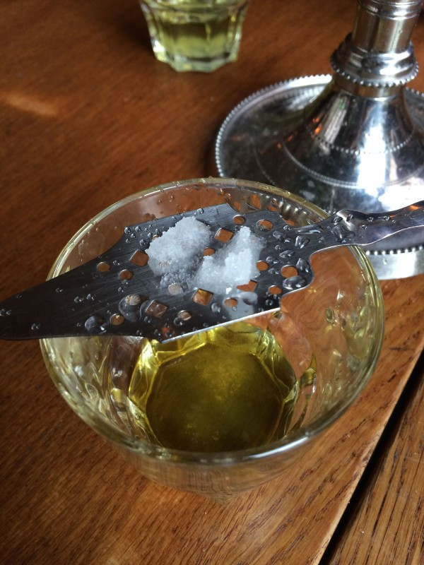 Disolving sugar cube over a beautiful absinthe spoon