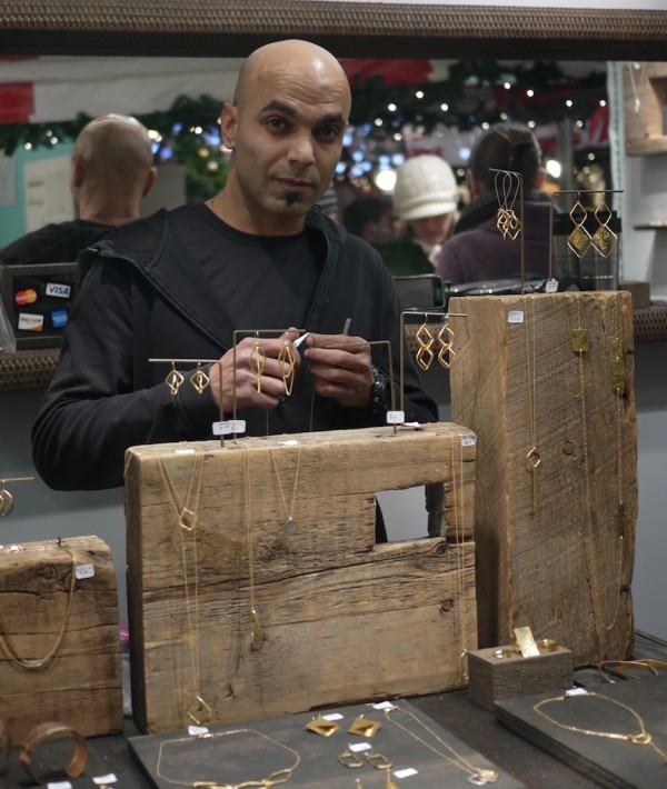 Shay Mehubad in his booth at the Union Square Holiday Market