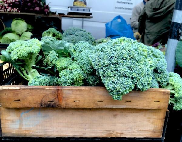 Box of Broccoli next to the Tamarack Hollow Farm tent at the Greenmarket