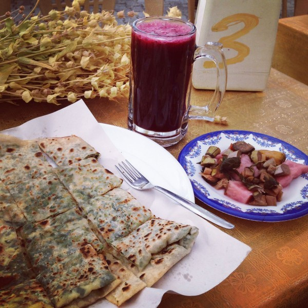 Ross's incredible market lunch of gozleme and a glass of fresh pomegranate juice