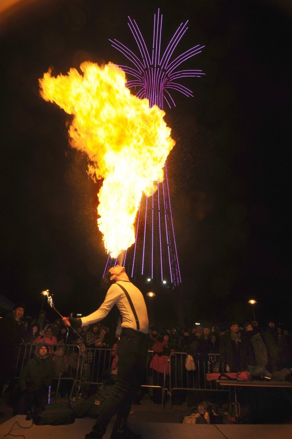 Ray Valenz Breating Fire at the 2015 New Year's Eve Parachute Jump Ball Drop (Photo by Norm Blake)