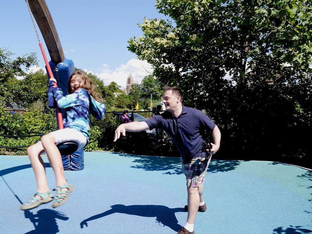Maddie and James in Brooklyn Bridge Park in Swing Valley