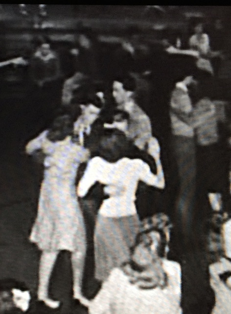 """Dad Dancing in the Monroe High School Gym in """"Letter to a Hero"""" (1943). Dad is the one at the top with the white collar and beige jacket."""