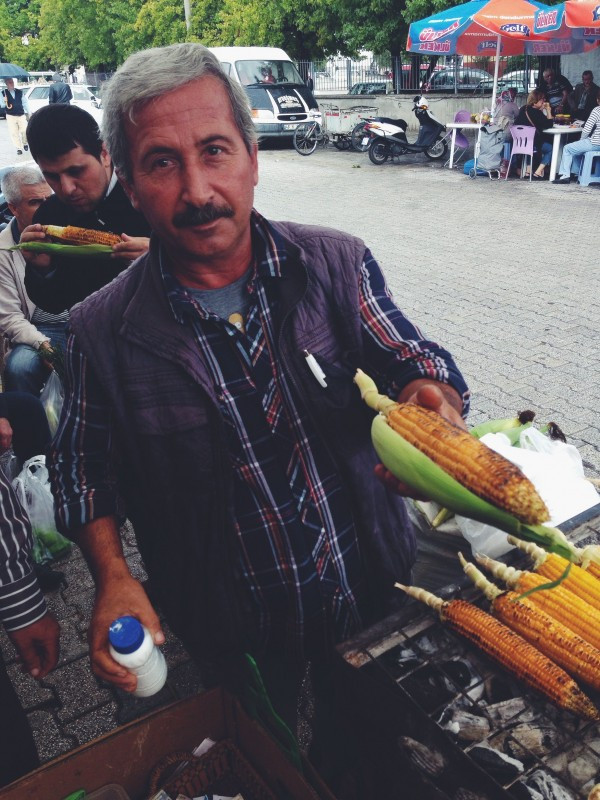Adem selling grilled corn