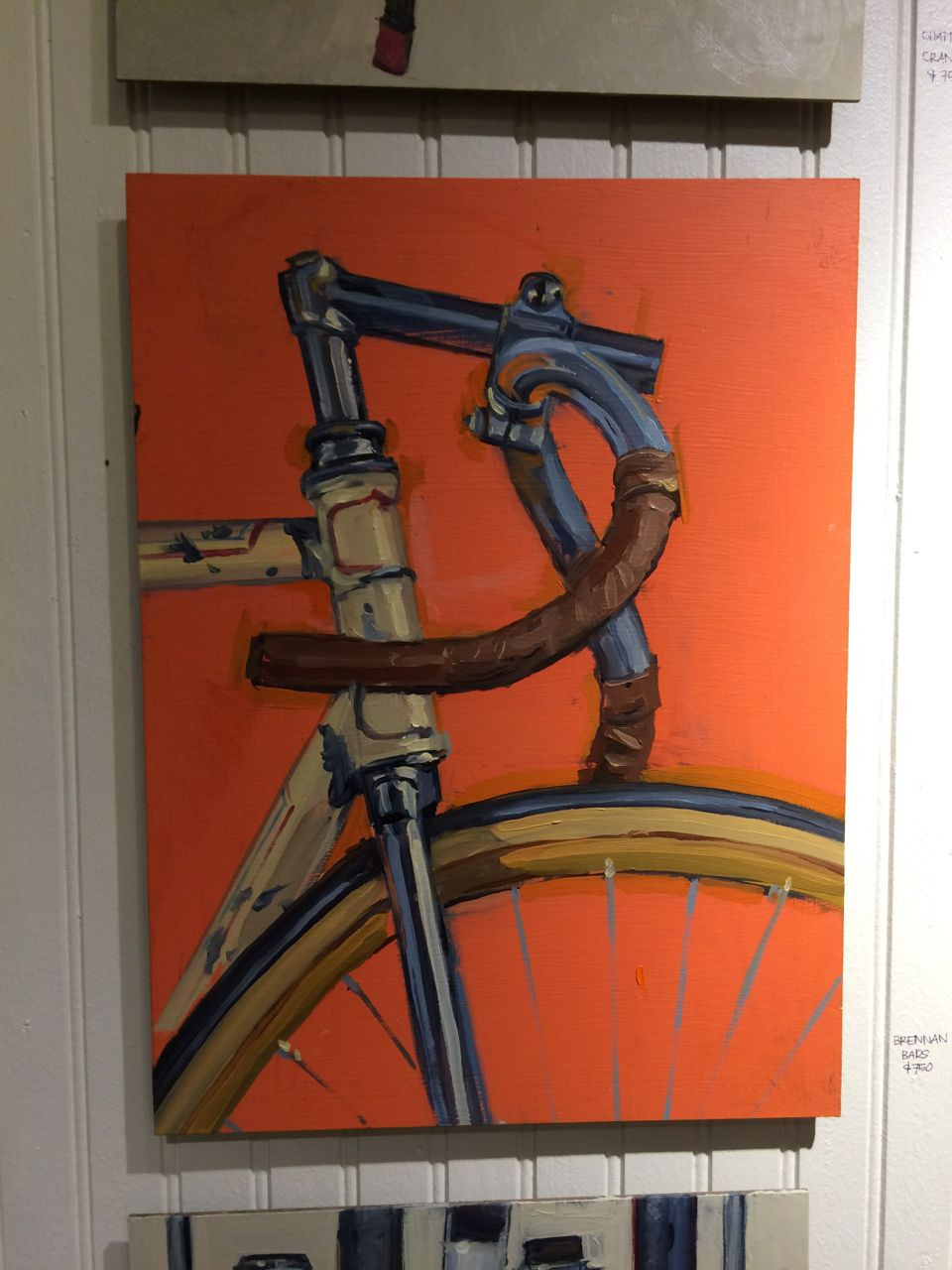 Cool leather grips and a bright orange background - by Taliah Lempert
