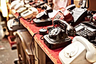 Old telephones in a row