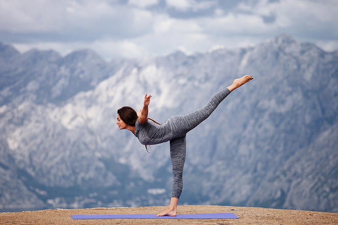 woman-yoga-practice-in-mountains-with-be