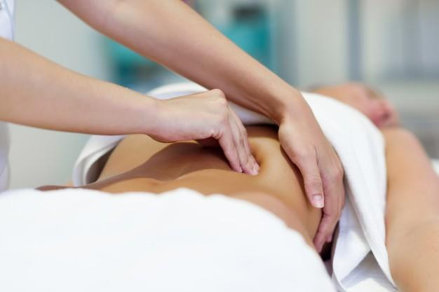 best massage point on back for aiding gut health