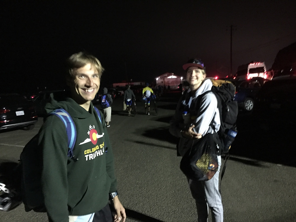 Two people standing in the dark on the way to Malibu Tri transition