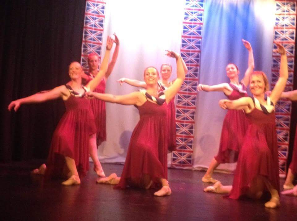 Adult Ballet dancers looking very happy at the end of their number!