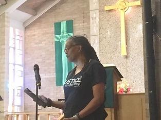 Image of Rachel Chapman speaking at an association meeting