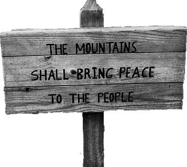 """wooden sign that states """"The Mountains shall bring peace to the people"""""""