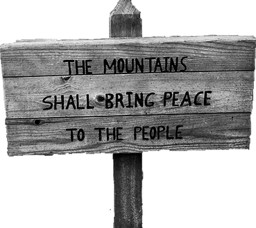 "wooden sign that states ""The Mountains shall bring peace to the people"""