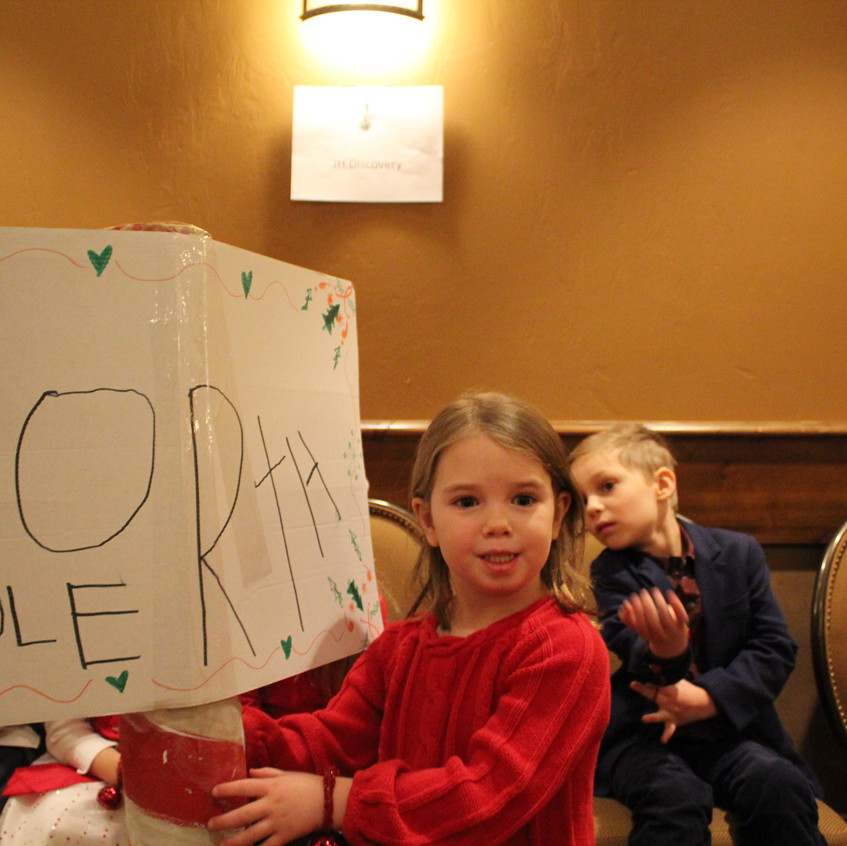 G holds our NORTH POLE sign
