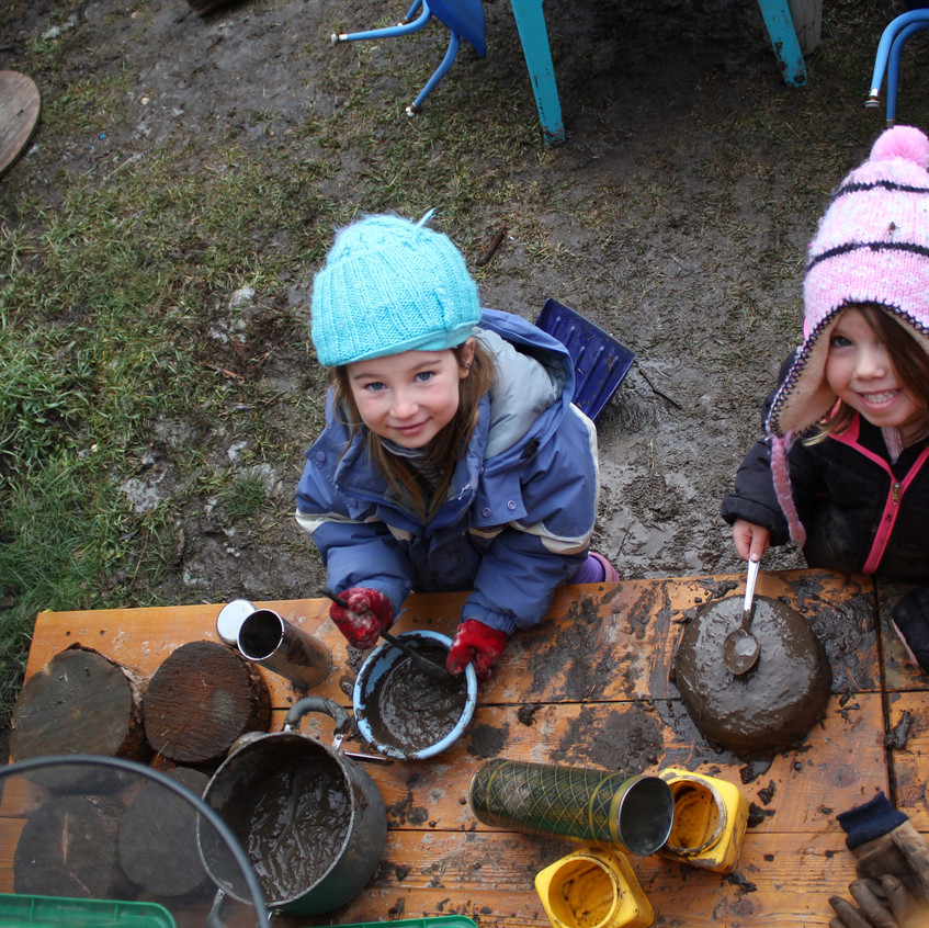 These 2 LOVE the mud kitchen!