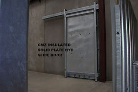 Insulated solid plate hydraulic slide doors